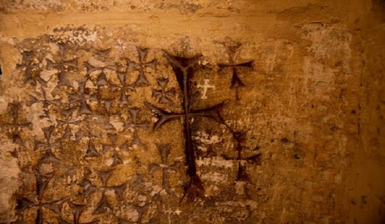 Graffiti or homage? Hi-tech imaging sheds light on Holy Sepulchre wall crosses
