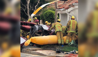 Helicopter crashes into house