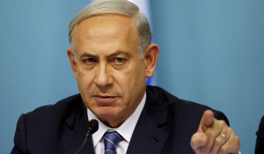 Israel threatens Iran with war