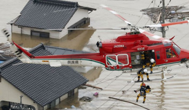 International agenda: flood kills over 100 in Japan